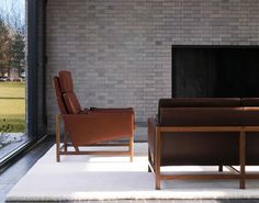 BassamFellows CB-510 High Back Lounge Chair and CB-53 Low Back Sofa with exposed solid Walnut frames.