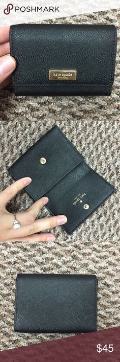 KATE SPADE WALLET Mini wallet! Fits about 15-20 cards for me! I'll stuff cash in there too! Very great used condition. THE ONLY REASON I'm getting rid of it is because I no longer wear leather goods. Otherwise I'd keep it. It's in fabulous condition!! Paid $58 at the outlet for it. I can do $40 shipped on 🅿️aypal with tracking! kate spade Bags Wallets