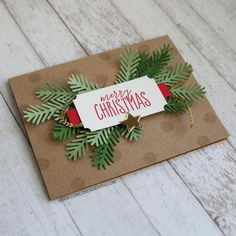 handmade Christmas card from Concord & 9th ... kraft base ... die cut fir branches ... red and gold embellishments ... luv the woodsy look ...