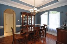 Barkston color idea for living room...  The elegant formal dining room is simply beautiful! The chandelier sits in a tray ceiling accented with crown molding. A decorator color compliments the room, along with chair-rail molding and gorgeous hardwood floors.