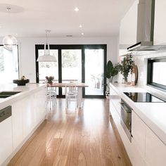Beautiful white kitchen. Like the white splash back