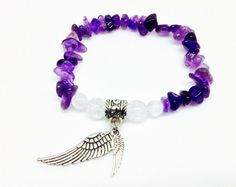 Amethyst is a very popular crystal, it's deep purple hues enchanting many. It acts to ward off negative energies, and protect people from stress. It calms the brain, easing headaches and migraines.  It is also a stone of sobriety, allowing for clear thinking and smart decision making.   https://www.etsy.com/listing/290430497/amethyst-bracelet-angel-wing-bracelet  Amethyst Bracelet, Angel Wing Bracelet, Angel Bracelet, Crystal Bracelet, Amethyst Jewelry, Angel Jewelry