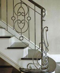 Ornate iron staircase railing at the Petit Palais.