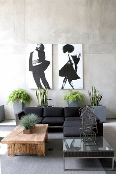 Concrete planters lend the houseplants in this living room a modern air we can't get enough of. We also love how the green serves as the third shade in a very tight color palette... Use charcoal gray concrete planters.