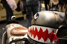 Toothy shark painted on motorcycle gas tank, I would add 4 .303 Browing machine guns to look like a WWII spitfire