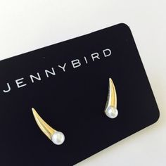 Jenny Bird Gold Dore Crawlers Earrings The Dore Crawlers with their modern style and shape, will be a perfect addition to your birdie collection. Gold- Dipped Brass/4mm glass pearl 1/2 long. __A40 Jenny Bird Jewelry Earrings