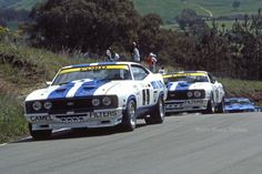 Two lovely Falcons! Make that 3 lovely Falcons cos I see one in the rearview mirror coming Australian V8 Supercars, Australian Muscle Cars, Aussie Muscle Cars, Ford Mustang Shelby, Ford Gt, Ford Torino, Old Classic Cars, Ford Falcon, Cool Cars
