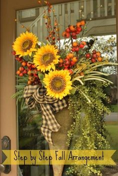 How to Make a Door Arrangement- You can follow these simple pictures and have a beautiful arrangement for your front door. MATERIALS-1 bushy green plant~1 trailing green plant~1 taller green plant~1 wispy stem that has a bit of color~1 cone shaped container~Green floral foam~Arrangement and Bow Instructions on site.