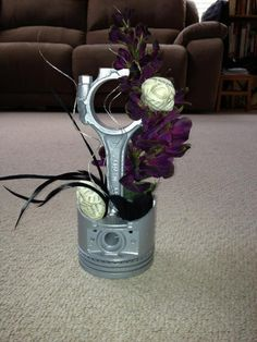 Car parts centerpiece. Kinda cool idea. You could get super creative on this one. vintage auto theme wedding.