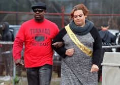 Trenton Central High School Vice Principal Dana Williamson (left) escorts Homecoming Queen Jae Irizarry during homecoming festivities at half time of the Trenton vs. Hamilton football game October 17, 2015.