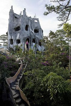 "Hang Nga Guesthouse in Dalat -  Mushrooms, spiderwebs, portholes, and tree roots are sculpted into the organic concrete form, and each of the 10 guest rooms at ""The Crazy House"" is named for an animal."