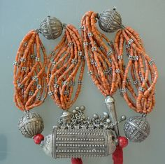 Yemen Silver and Coral Kutub Necklace | Stunning necklace from the Yemen silversmiths. The center bead called a Kutub, and the Round beads called flower Bawsani beads (with a hallmark form the silversmith), mixed with mediterranean coral and small silver beads. Circa late 19th Century | 9,950 dollars