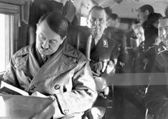 """There's a common photo taken right before this one, but this is the """"outtake."""" Hitler in leather, 1934. Schaub, Otto Dietrich and Karl Brandt laughing behind. (via putschgirl)"""