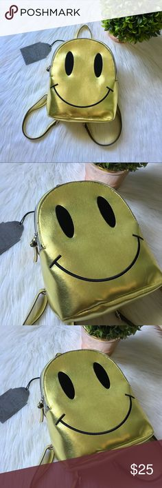 NEW gold smiley face backpack Smile now , cry later! Mini gold backpack. Perfect for raves & festivals! Remind me of unif & dollskill for some reason. Very spacious. Check my closet out to bundle and save 10%. Bags Backpacks