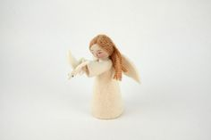 Gift of Peace Angel - Handmeade witj merino wool form the mointains of Kyrgyzstan with some embroidered details. $16