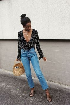 Make a instant outfit with a polka dot blouse, your favorite jeans, basket bag and sandals
