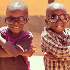 "Andrew and his mate pulling off the ""Bad Boys"" look. Kampala,Uganda Africa"