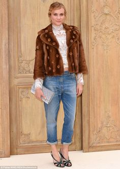 Perfect as usual:  Diane Kruger made a statement at the Valentino show during Paris Fashion Week on Sunday, as she opted to wear jeans