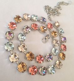 Swarovski crystal necklace - peach, blue and just a beautiful summer time arrangement -designer inspired crystal necklace