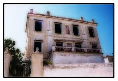 An abandoned house on the island of Spetses. John Fowles lived on Spetses for a while, which served as inspiration for the island Phraxos in his novel, The Magus.