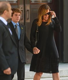 Melissa Rivers and Cooper Endicott hold tight to each other as they leave the memorial service.
