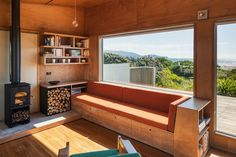 Built-in seating offers a view of the Kapiti Coast beach outside this bach renovated by Gerald Parsonson of Parsonson Architects. Photograph by Paul McCredie Built In Sofa, Built In Furniture, Built In Seating, Art Furniture, Built Ins, Painted Furniture, Furniture Design, Plywood Interior, Casa Loft