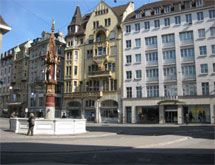 Basel Old Town, with its winding lanes and well preserved medieval buildings, many of which now house boutiques ...
