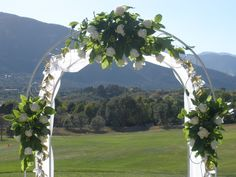 Wedding Arch - flowers taken and used on buffet table after ceremony