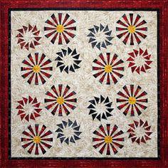 Black background with bright fabrics to look like fireworks? Prairie Pinwheels by Judy Neimeyer