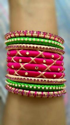 Pink Crossed and Green Silk Thread Bangles Note: This is a made-to-order product and will be shipped within 7 to 10 days from the order date. Silk Thread Bangles Design, Silk Bangles, Thread Jewellery, Silver Bracelets, Bangle Bracelets, Fabric Jewelry, Silver Rings, Anklet Designs, Bangle Set