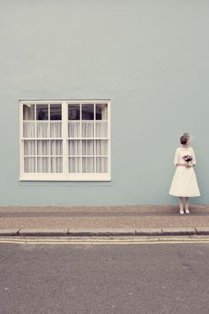 Sussex based vintage style photographer.  quirky fun wedding bride posie country flowers bouquet brighton cocktail hat short wedding dress