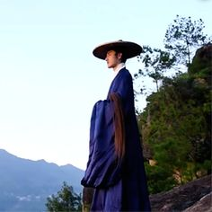 A young Chinese Daoist in deep mountain, Fujian Province