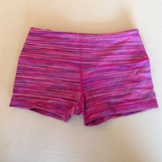 NWOT Glyder Hot Pink Space Dye XXS Boogie Short NWOT! Beautiful space dye pattern in purple, hot pink, and fuschia. Although it is made by Glyder, these shorts are identical to Lululemon Boogie Shorts in size 2. Super cute! The material is almost exactly the same as Luon, too. There is a small pocket in the front for a gym locker key. Happy poshing! Glyder Shorts