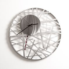 """Contrails Wall Clock 16"""" by Ken Girardini and Julie Girardini. Intersecting lines of laser-cut steel look like airport runway patterns on the earth. Black hands and pendulum. Uses one AA battery (included)"""
