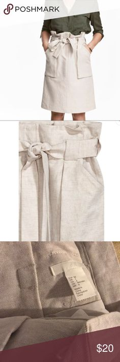 H&M Cargo Skirt with Belt Cargo skirt in a woven cotton blend with patch front pockets, a wide tie belt at the waist, zip fly and hook-and-eye fastening.  COMPOSITION Cotton 55%; Linen 45% Lining: Polyester 100% CARE INSTRUCTIONS Machine wash at 40° ITEM NR. 0466815001 H&M Skirts Midi