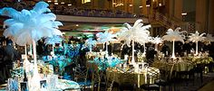 Table centres with height such as lilly vases with ostrich feathers are great and really have a wow factor!