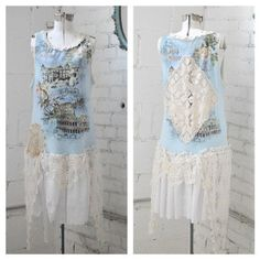 This dreamy romantic shabby sundress is a one of a kind up cycle by Black Rain Couture.  This gorgeous piece is a pale blue shabby Rome graphic, embellished with lavish vintage lace crochet, and an eyelet bottom  The front side of the dress is ruched and tied with lovely coordinating ribbons and lace.  The back of this dress has a vintage crochet cut out centre.  Simply comfortable and beautiful to wear this season.  This dress is best fitted to sizes medium to large, please see measurements…