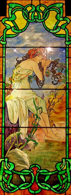 Art nouveau stained glass window from the Smith Museum of Stained  Glass at Navy Pier in Chicago, Illinois.  One of a set representing  the four seasons; this is Summer.  The designer is not known with  certainty, but it is believed that Alphonse Mucha designed the four  panels.
