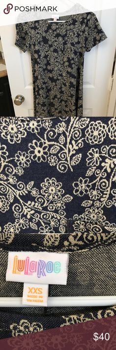 LulaRoe Carly Carly Dress - never worn but tag removed. Navy and Cream. Very pretty LuLaRoe Dresses High Low