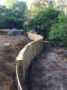 curved oak sleeper wall in progress