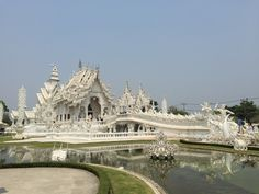 Wat Rong Khun aka the White Temple in Chiang Rai, #Thailand. A modern temple built in 1997 designed by Chalermchai Kositpipat, a Thai architect. #yourtravelfriends #travel #WatRongKhun #WhiteTemple #temple