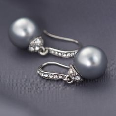 """""""Grey Pearl Pave' Crystal Drop Earrings Silver"""" These earrings as so perfectly classic, you'd expect to find them in an elegant lady's jewelry box from most any decade. A lustrous, silvery grey glass pearl dangles opulently from a graceful French wire in gleaming silvertone with diamond-like crystal pave' for maximum allure. Whether you pair them with a cashmere sweater or an haute couture gown, you'll want these earrings in your own jewelry box for decades to come."""