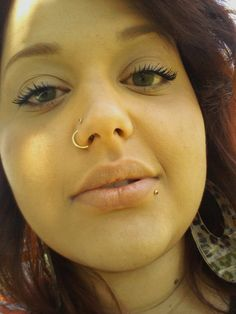 I LOVE this double nose piercing. I have never thought of that, but it looks great!