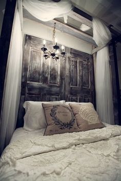 Reclaimed Door Headboard!  Love the romantic chandelier!
