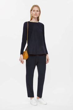 This jumper is made from light-knit cotton with a contrast triangular panel and skirt. An A-line fit, it has a wide round neckline, long sleeves and ribbed edges.
