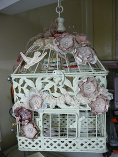 birdcage decorated with flowers cut from cricut...