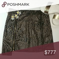 "Leopard print skirt NWOT New without tags  Sassy and sexy animal print skirt. Edgy hem detail, longer on sides and shorter in the middle. Pair with a tank top and denim jacket or with a sexy top and heels! This is the perfect addition to your skirt collection.   Brown and black with gold zipper details Hidden side zipper Size small  100% polyester Waist side to side 14"" Length at longest point 15.5"" at shortest point 14"" Manufactor/Brand tag is not on skirt) Skirts"