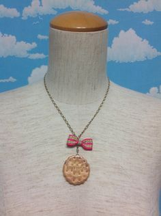 Biscuit Stripe Bow Necklace in Beige from Emily Temple Cute - Lolita Desu