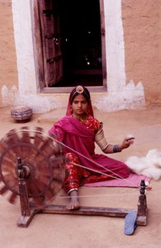Weaving yarn on 'Charkha'...