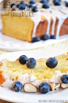 A perfectly moist and lemony Gluten Free Lemon Pound Cake with Vanilla Glaze topped with almonds and fresh blueberries. Does life get much sweeter???